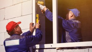 workers-specialized-form-install-plastic-windows-home-building-repair